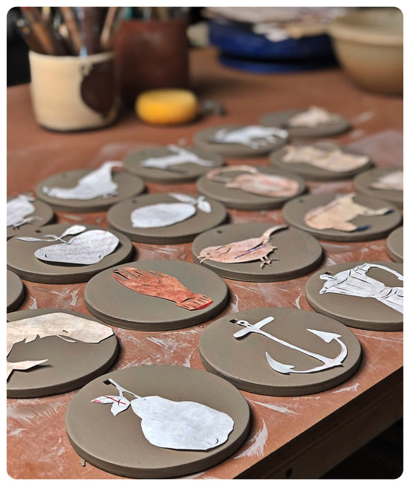 Clay tiles on work table