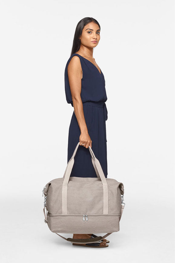 short woman with Catalina Deluxe Small - holding at side