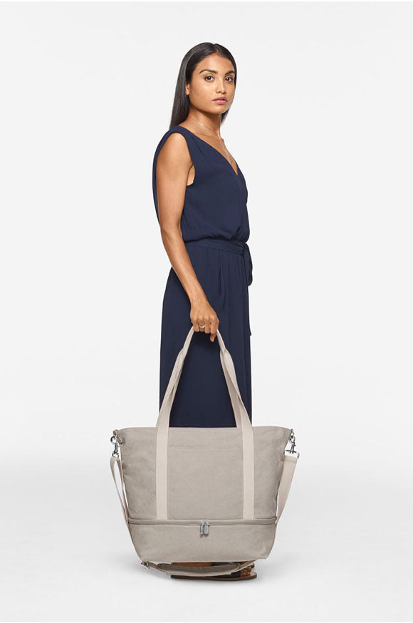 short woman with Catalina Deluxe Tote - holding at side
