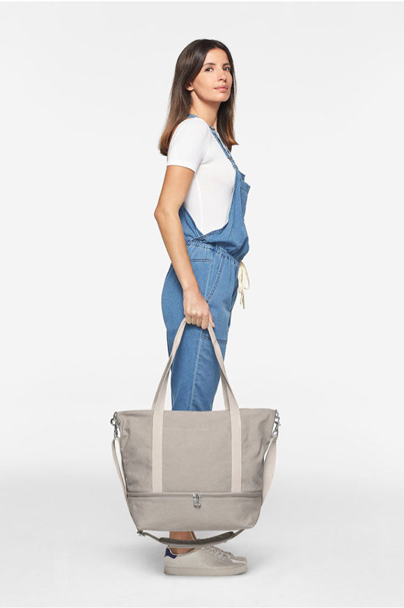 tall woman with Catalina Deluxe Tote - holding at side