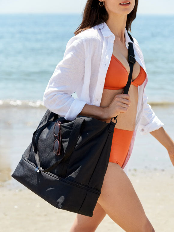 woman at beach with The Catalina Deluxe Tote on shoulder