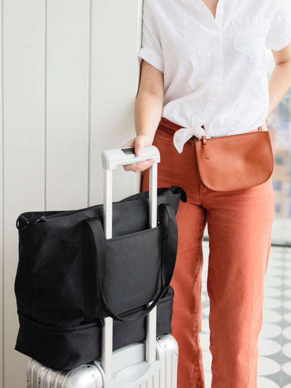 Catalina Deluxe Tote slid onto luggage handle