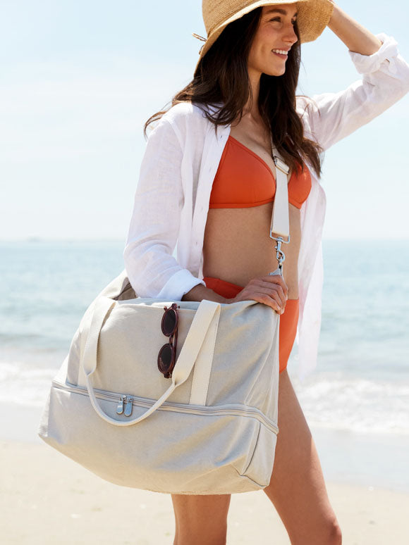 woman at beach with The Catalina Deluxe on shoulder