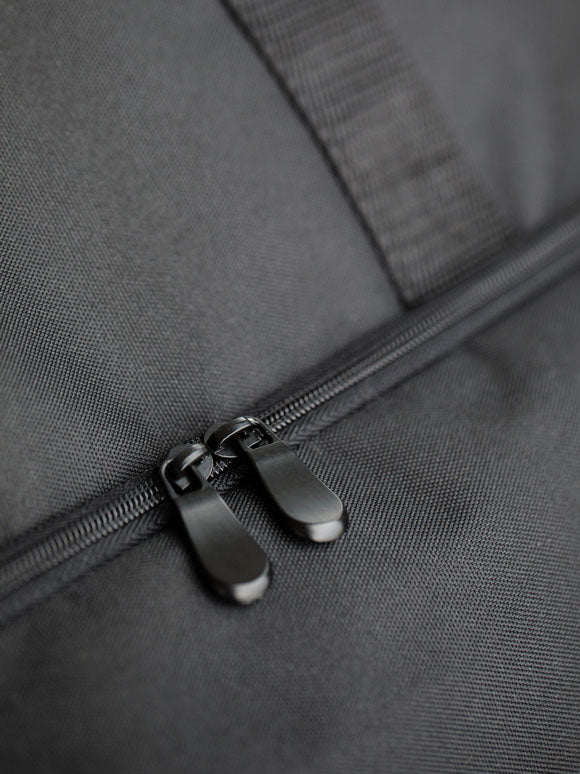 close up of 600D Recycled Poly material and zipper
