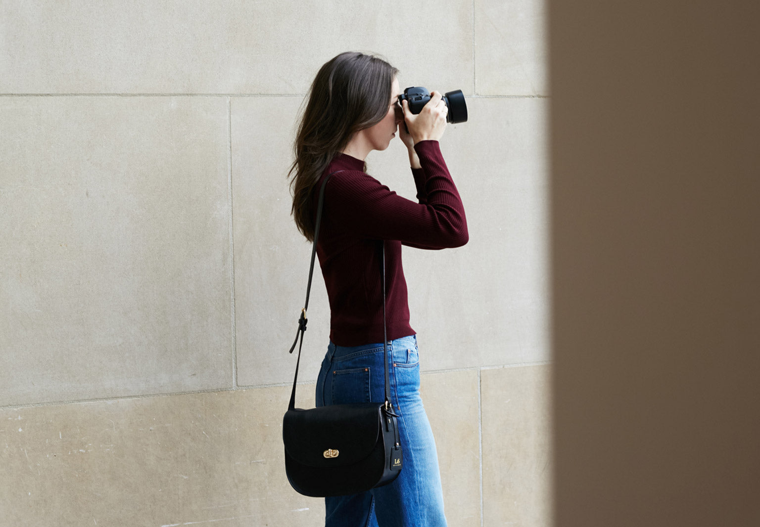 The Claremont camera bag, a stylish crossbody camera bag for DSLR cameras