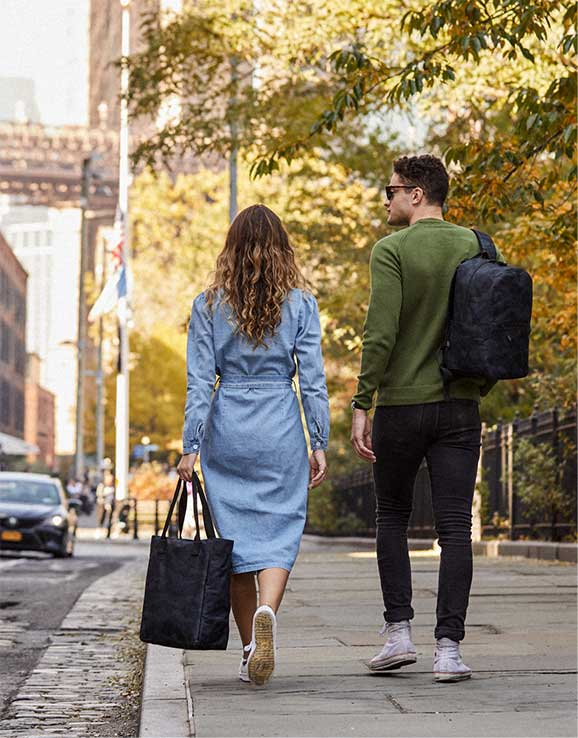 woman and man walking away with camo products