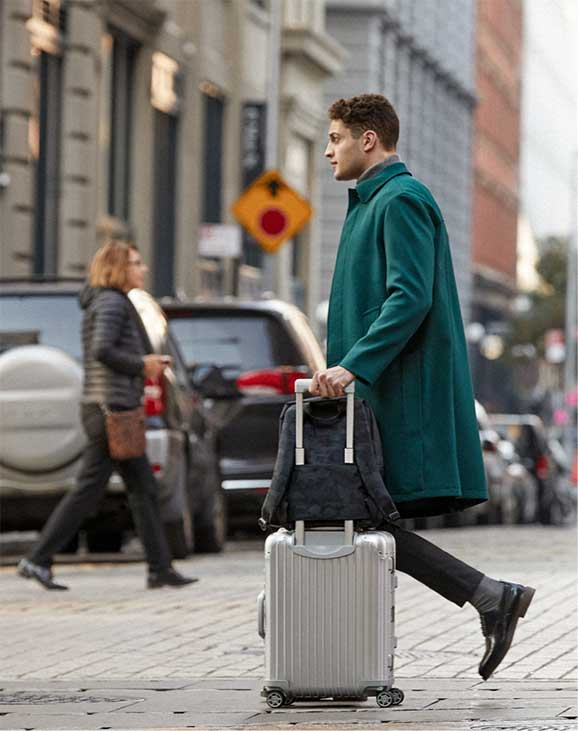 man walking with Hanover on luggage