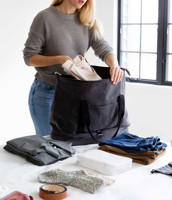 woman packing Catalina Deluxe