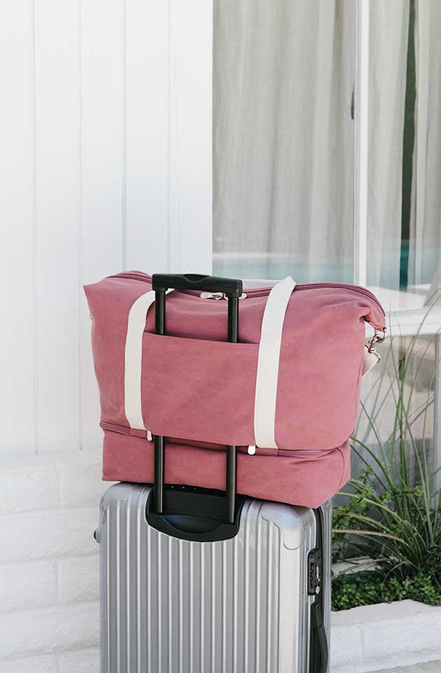 catalina deluxe in rose on suitcase