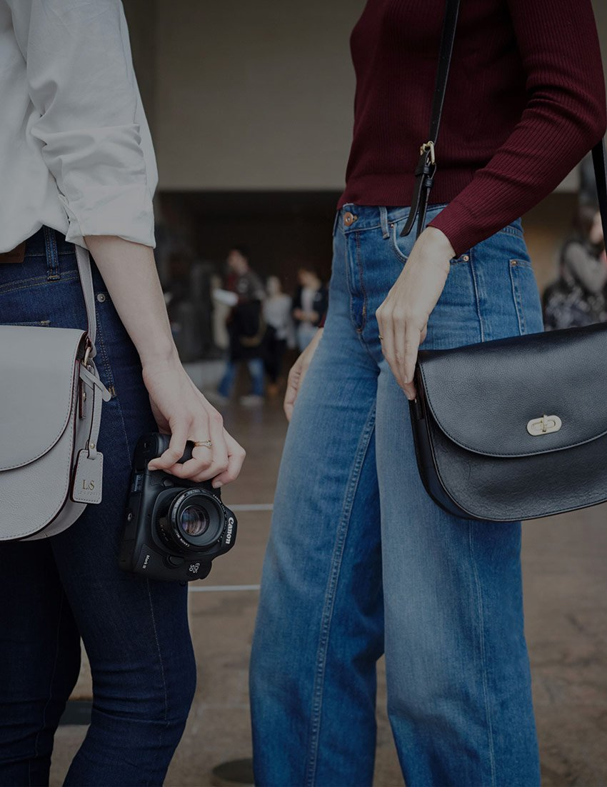 two women with Claremont bags
