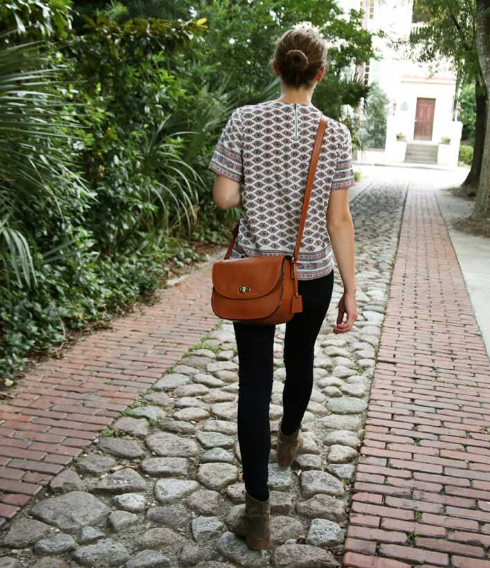 view from behind of woman wearing Claremont bag