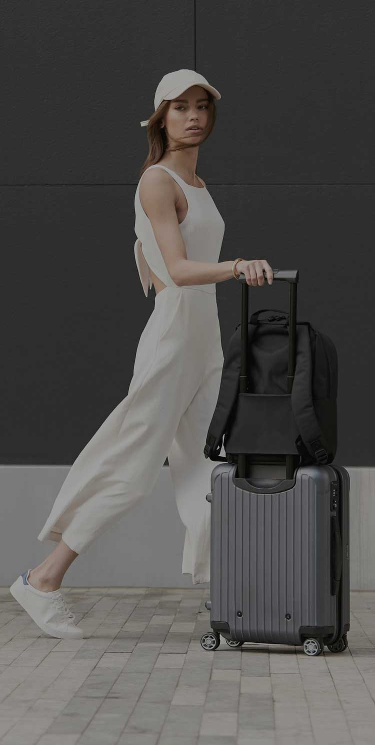 woman walking with Hanover on suitcase