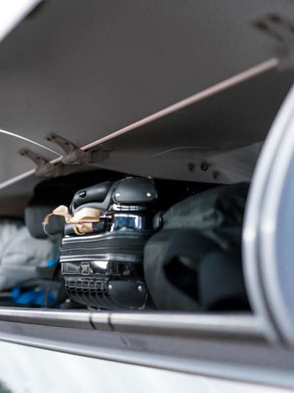 bag in airplane overhead compartment