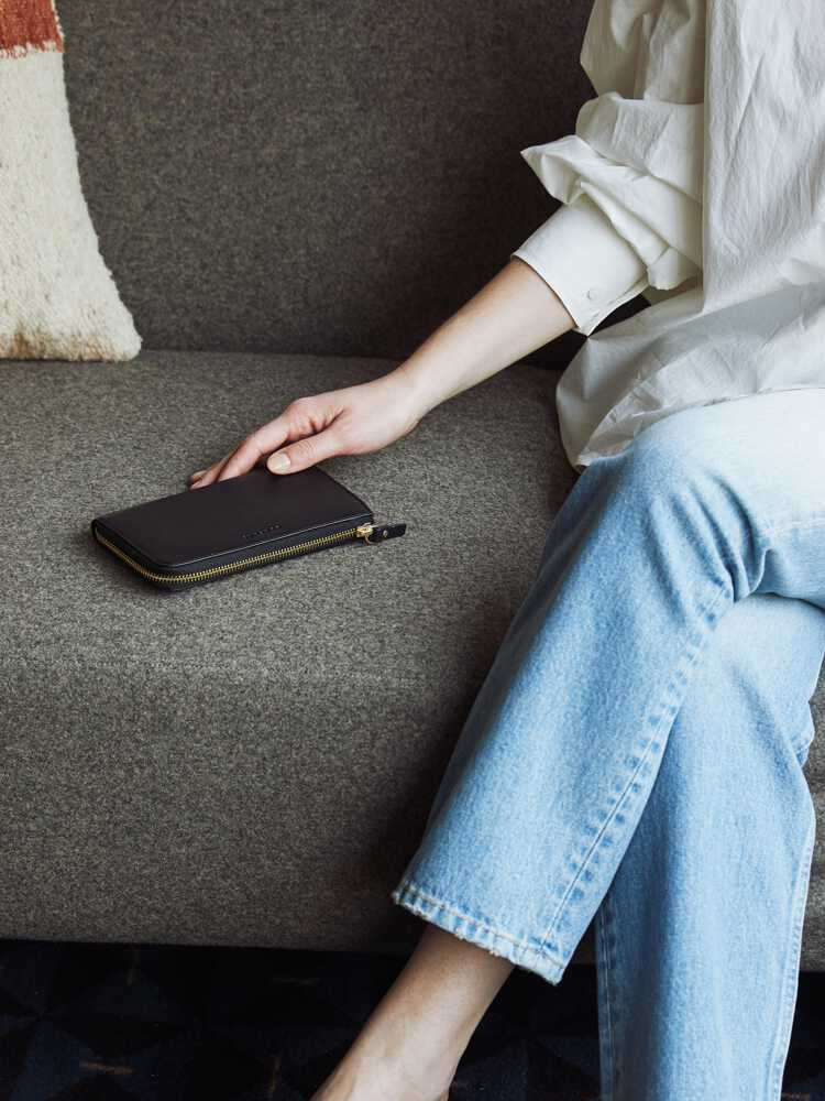 woman sitting on couch with Leather Wallet