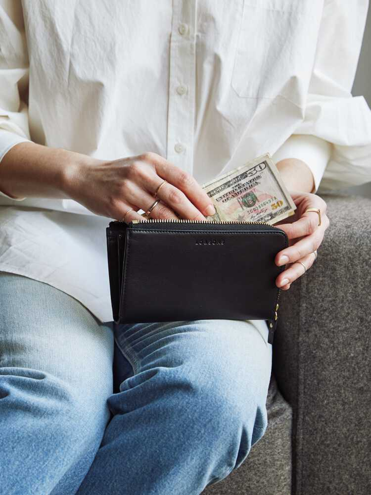 woman putting money in Leather Wallet
