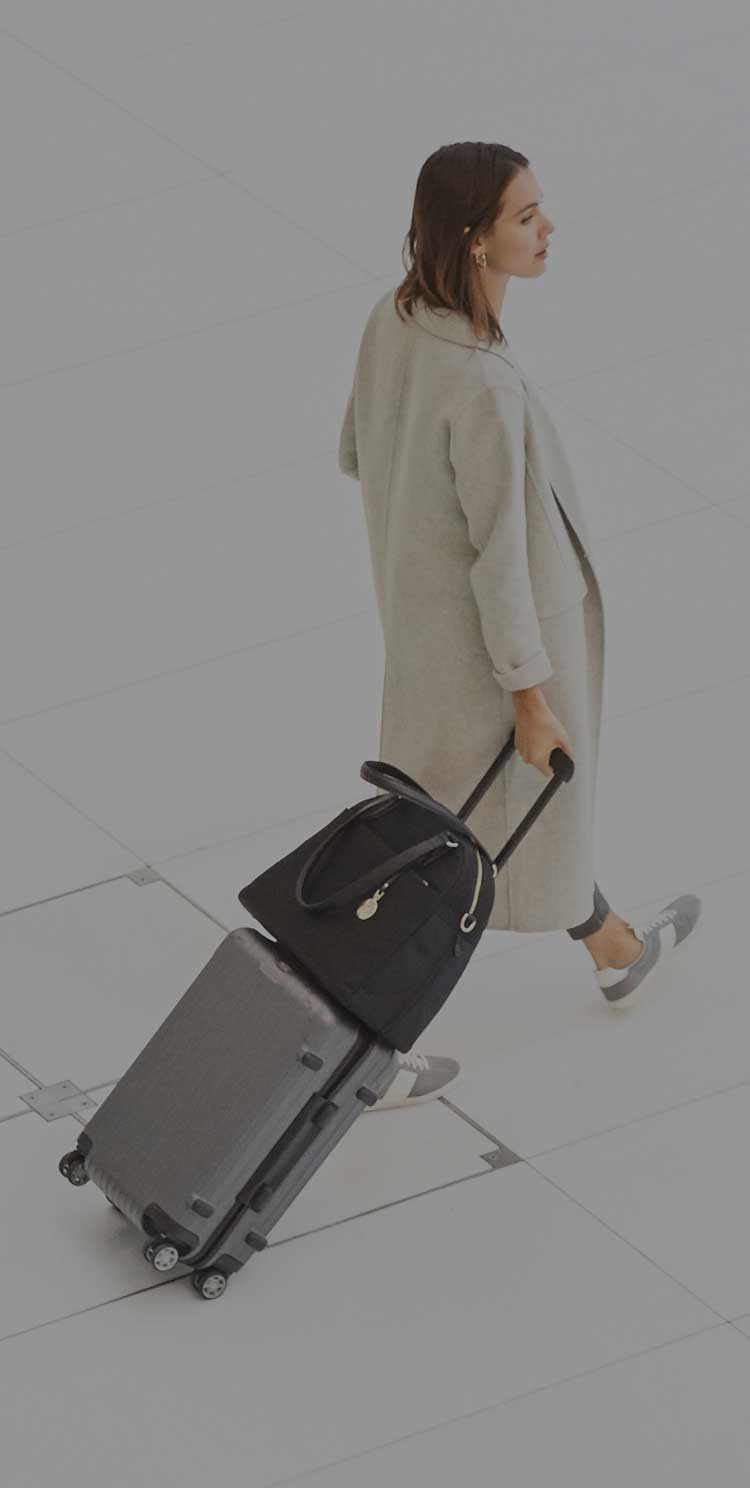 woman with O.G. on luggage