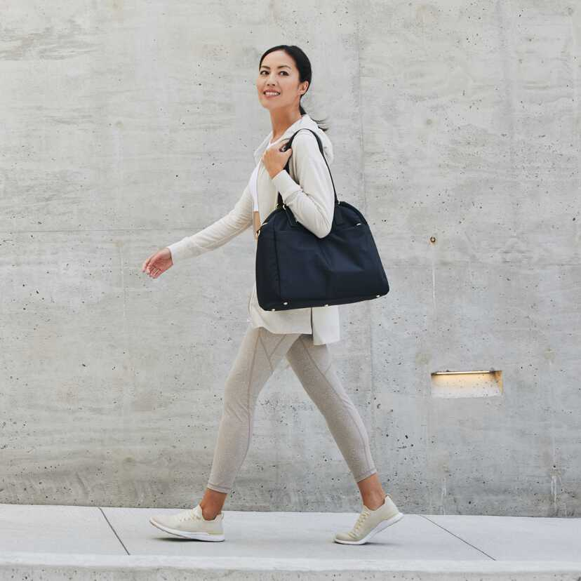 woman walking with O.G. 2 over shoulder