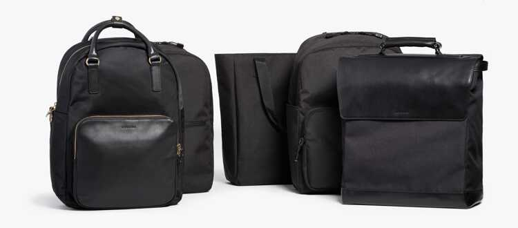 group of Lo & Sons backpacks