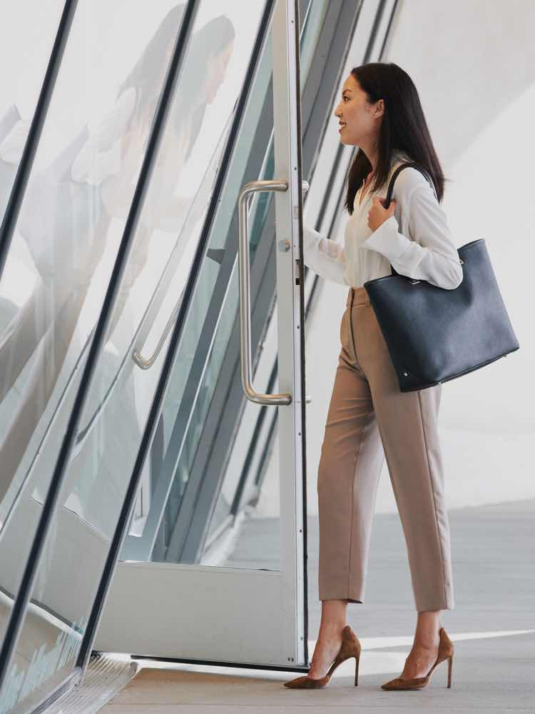 woman walking into building Seville Tote