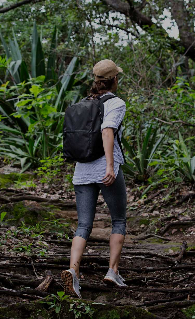 woman hiking in jungle