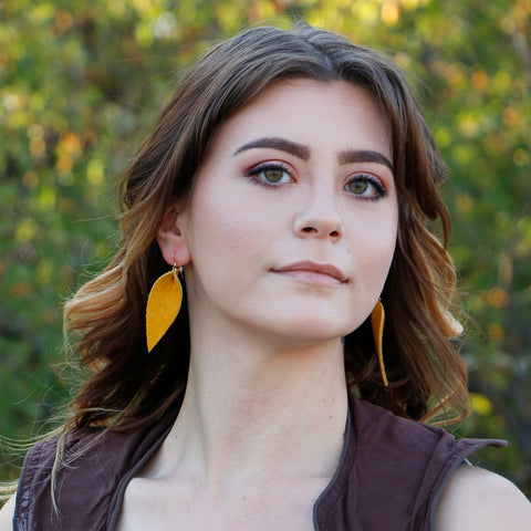 Model Wearing  Mustard Petal Leather Earrings with 14 k gold filled hooks