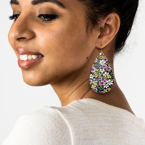 Woman with Leather Earrings Teardrop Design  with 1970s Floral Pattern