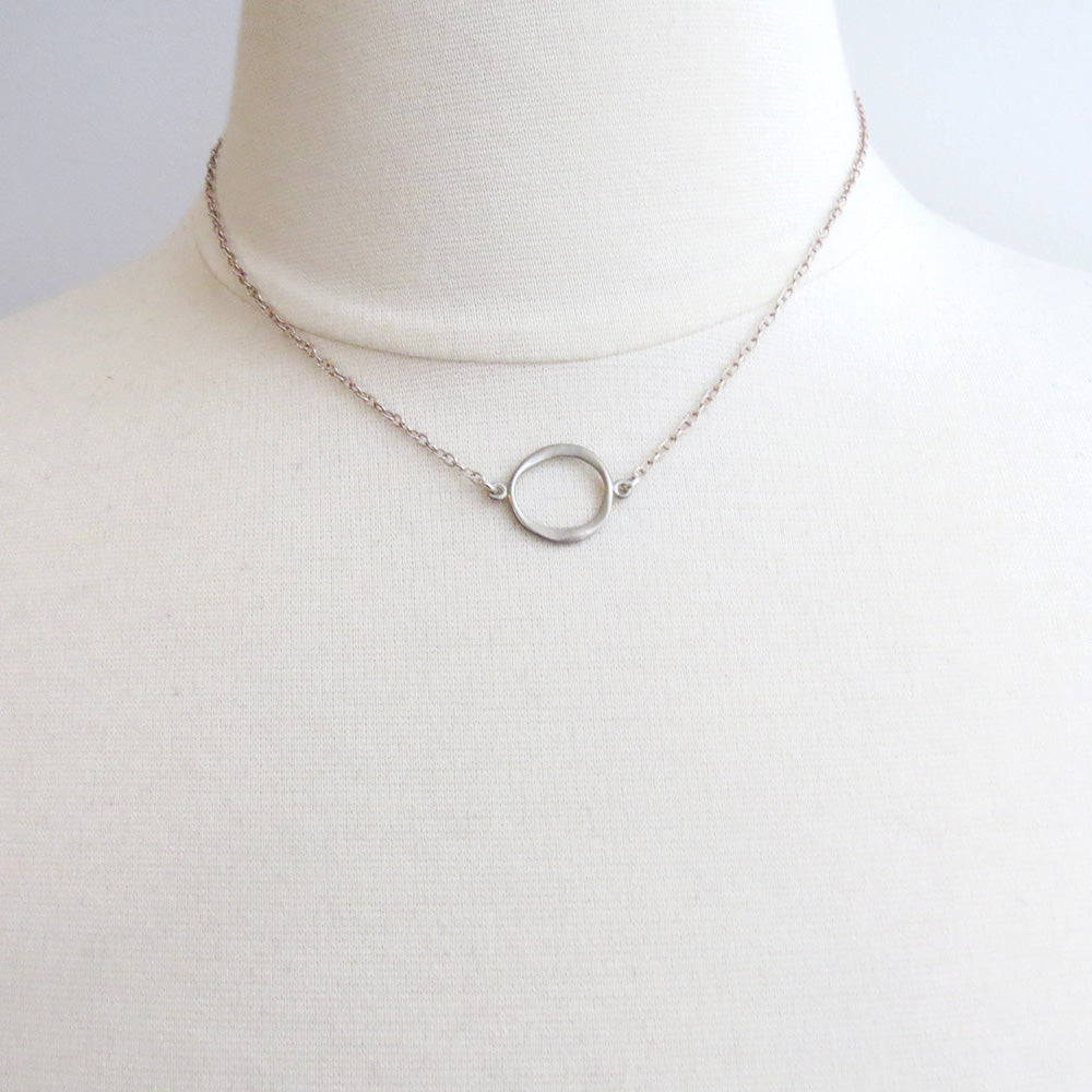SMALL STERLING SILVER TAPERED CIRCLE ON CHN