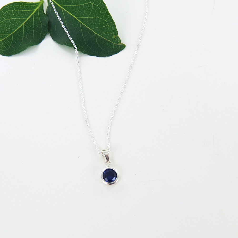 6.5 MM SYNTHETIC SAPPHIRE BEZEL SET PENDANT