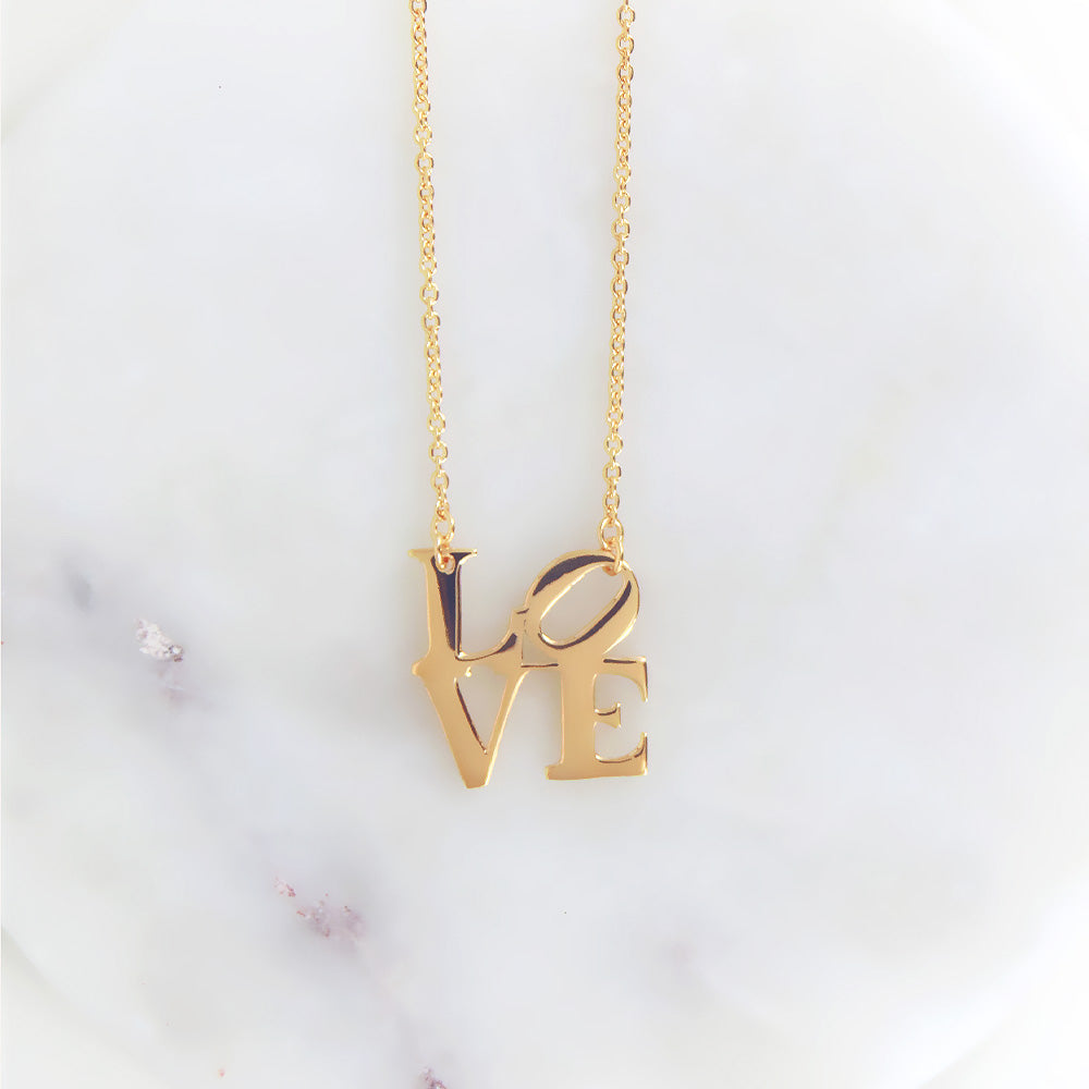 POLISHED VERMEIL LOVE SCULPTURE NECKLACE