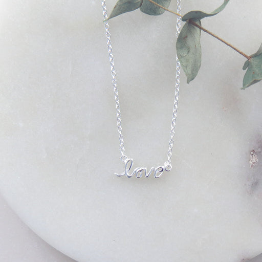 TINY CURSIVE LOVE NECKLACE
