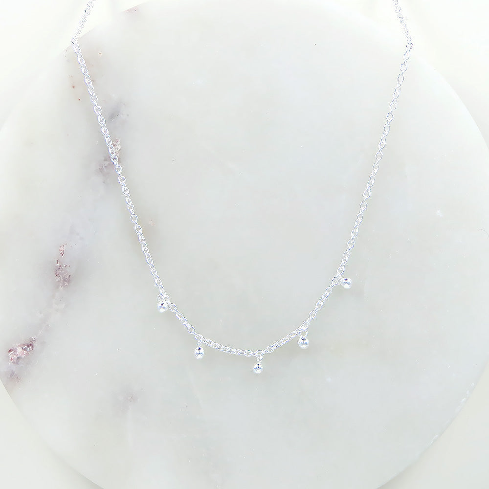STERLING SILVER NECKLACE WITH 5 TINY CHARMS