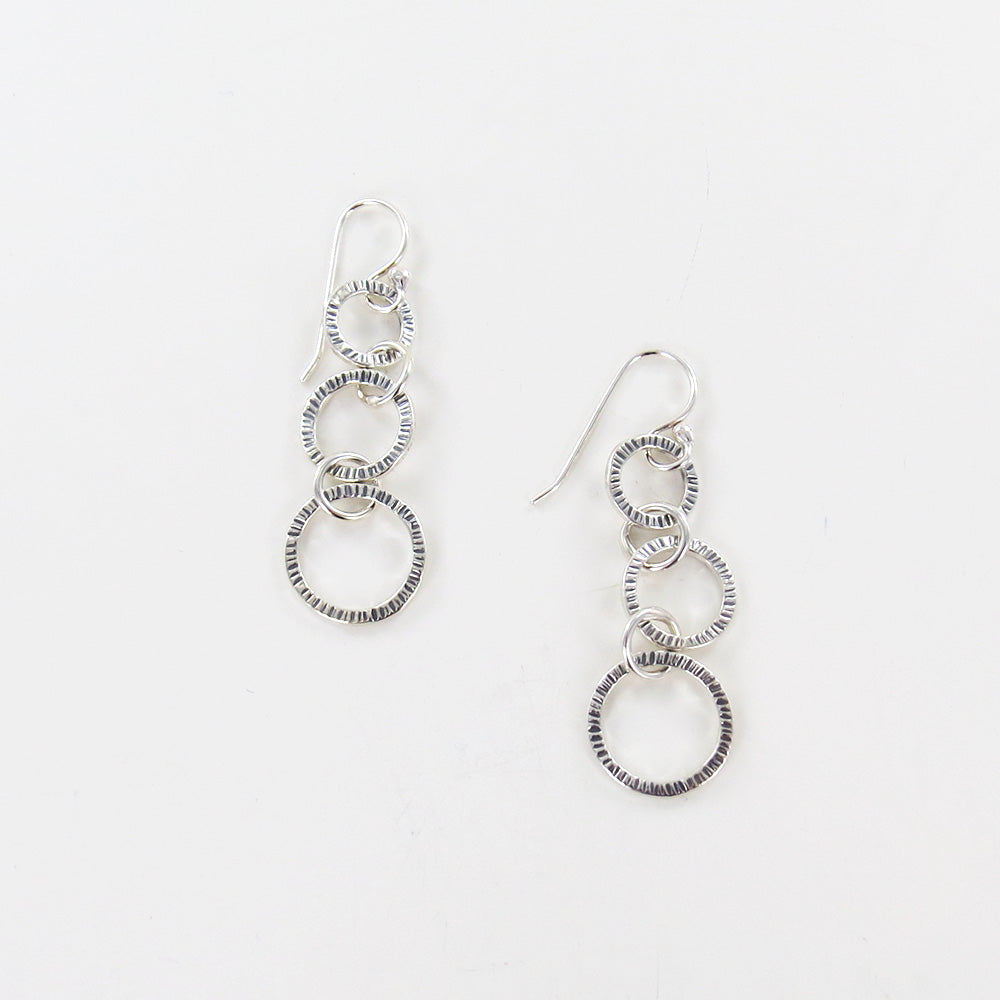 TRIPLE STAMPED LOOP EARRINGS
