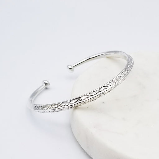 VINE PATTERN TOP KNIFE EDGE WITH BALL ENDS STERLING SILVER CUFF