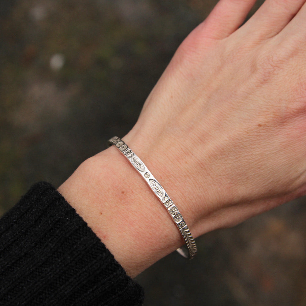 Stamped Fish and Fern Bangle