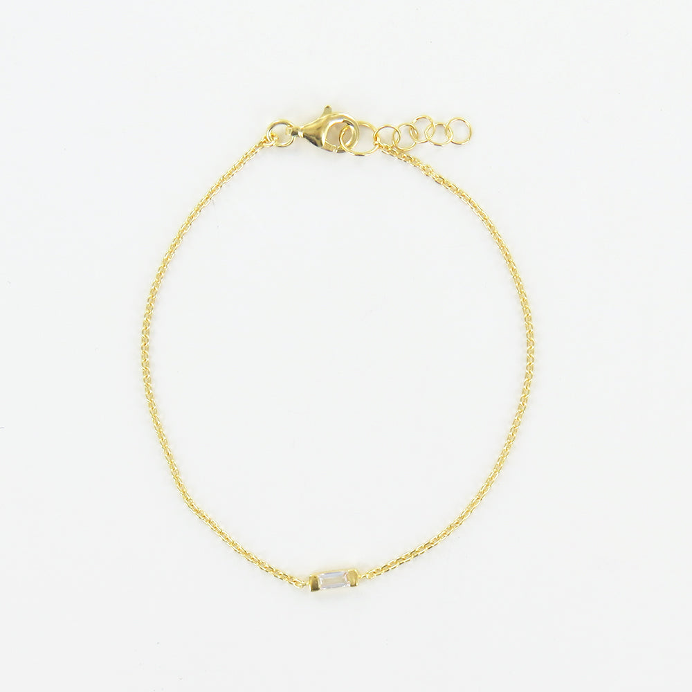 GOLD BRACELET WITH CHANNEL SET WHITE TOPAZ
