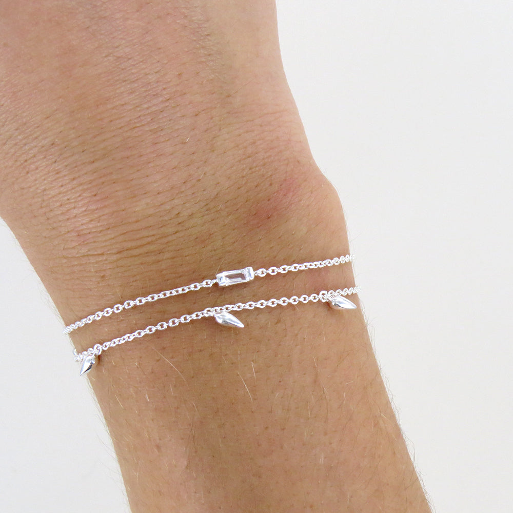 STERLING SILVER BRACELET WITH CHANNEL SET WHITE TOPAZ