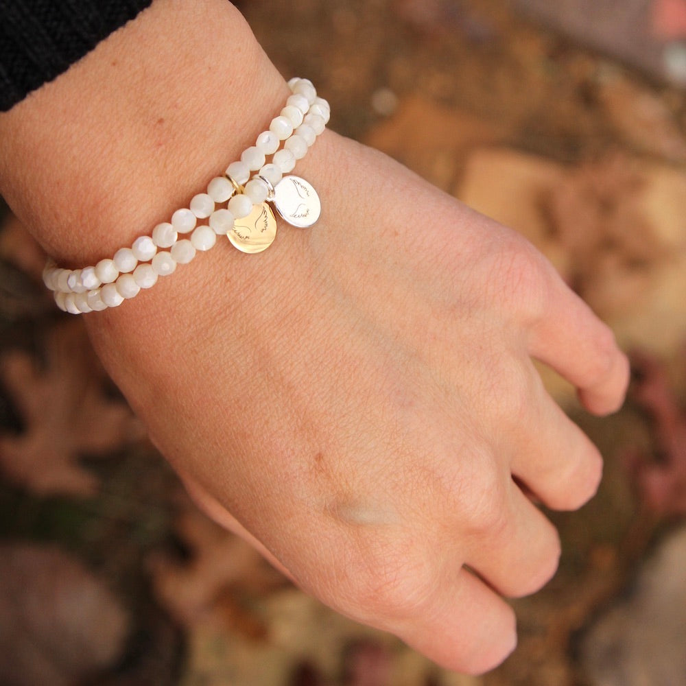 Guardian Angel ~ Stretchy Mother Of Pearl Bracelet - Silver Charm