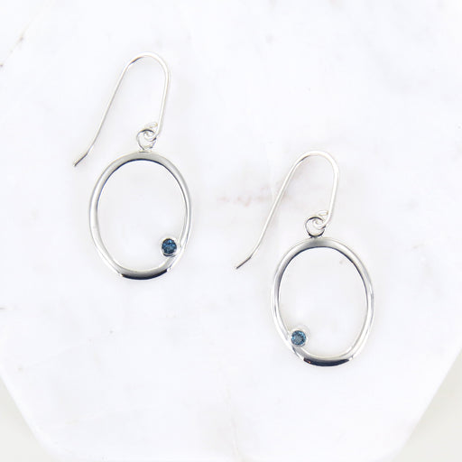 SILVER OVAL DANGLE WITH BLUE TOPAZ