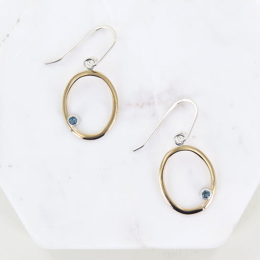 GOLD OVAL DANGLE WITH BLUE TOPAZ