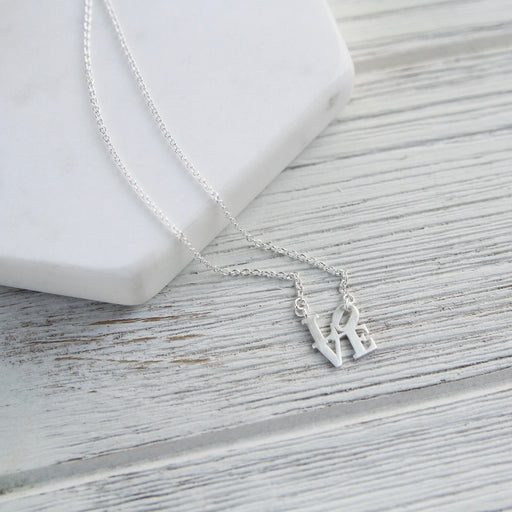 Matte Silver Mini LOVE Sculpture Necklace