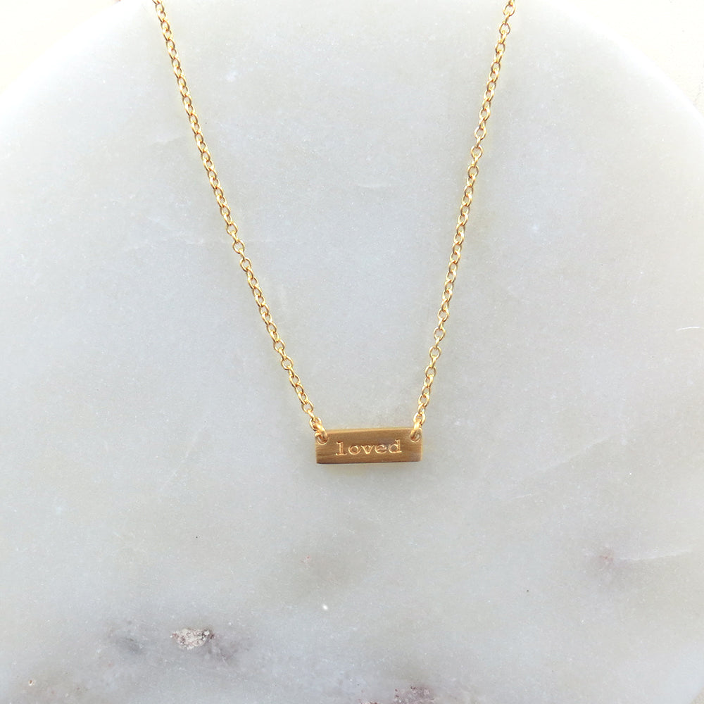 """LOVED"" TINY PLATE BRUSHED GOLD NECKLACE"