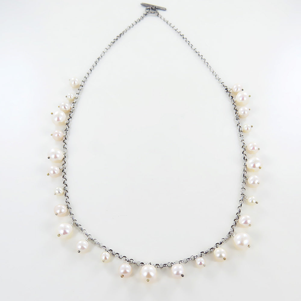 WHITE PEARL CHARMED NECKLACE