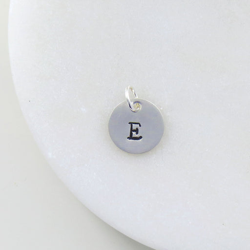 "SMALL DISK ""E"" STAMP"