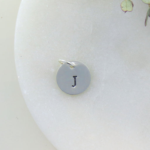 "SMALL DISK ""J"" STAMP"