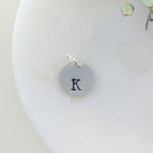 "SMALL DISK ""K"" STAMP"