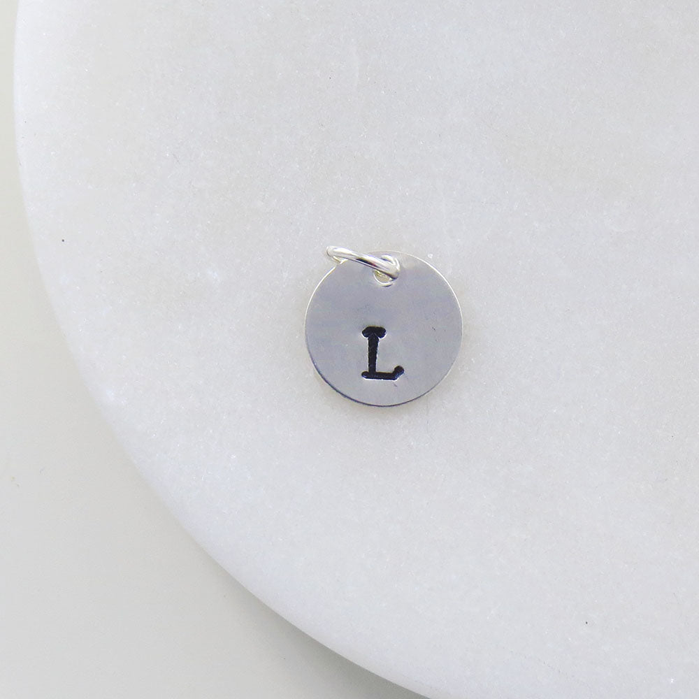 "SMALL DISK ""L"" STAMP"