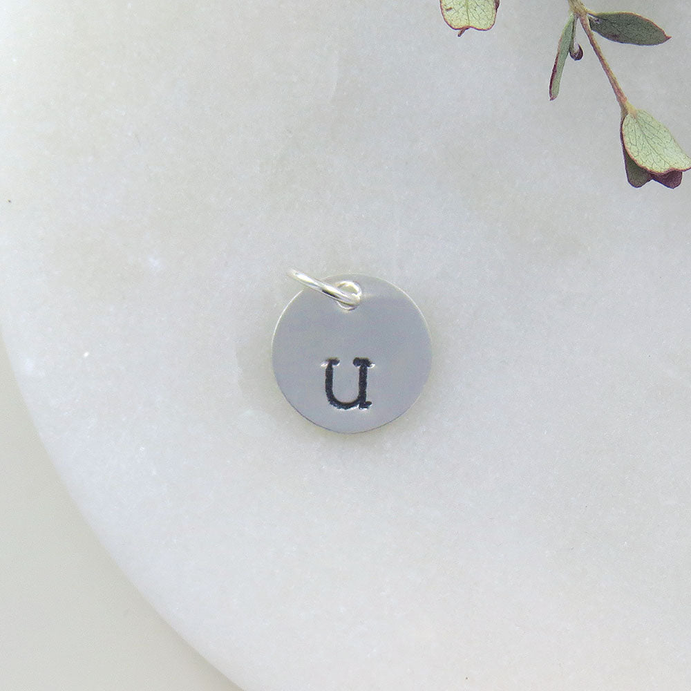 "SMALL DISK ""U"" STAMP"