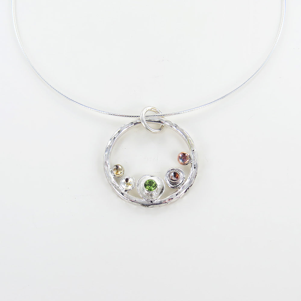 PEBBLES ON THE BEACH PENDANT WITH PERIDOT
