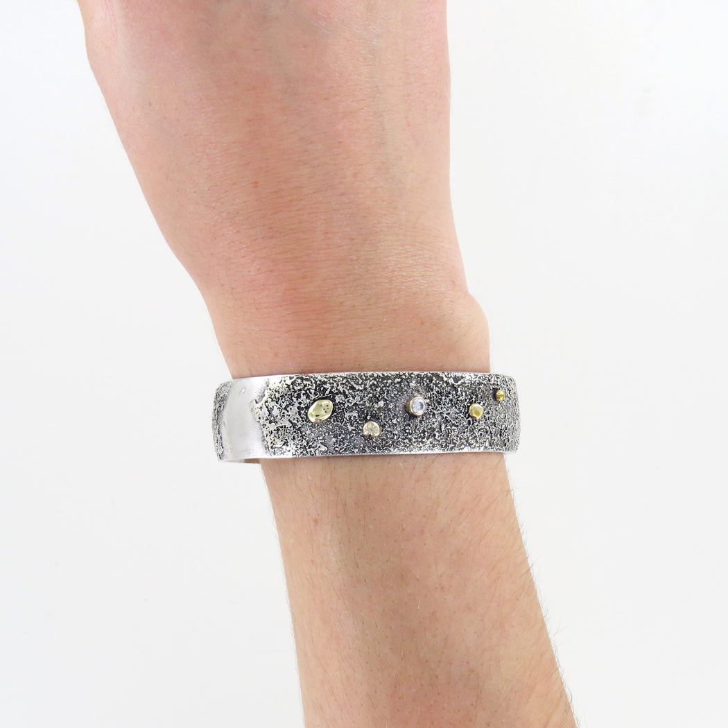 SILVER RETICULATED CUFF WITH TOPAZ AND BRONZE ACCE