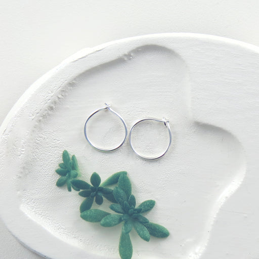 TINY TINY STERLING SILVER HOOP